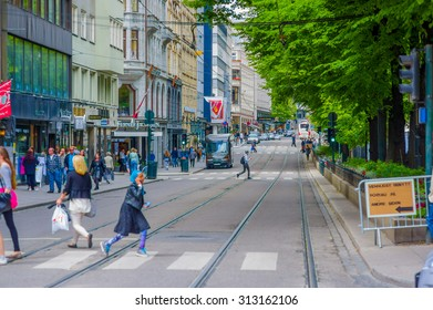 OSLO, NORWAY - 8 JULY, 2015: Daily life in busy street called Stortingsgaten, rails of tram visible .