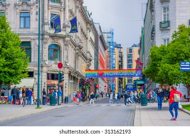 OSLO, NORWAY - 8 JULY, 2015: Beautiful architecture concrete buildings in Rosenkrantz gate with a pro homosexual banner stretching across.