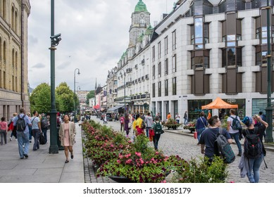 Oslo, Norway, 8/10/2018, The Storting is the supreme legislature of Norway, located in Oslo.People walk the street.