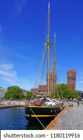 OSLO, NORWAY -9 AUG 2018- Opened in 1950, the City Hall building (Radhus) overlooking the Oslo Norway Harbor is a main landmark in Oslo.