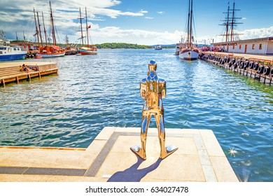 OSLO, NORWAY - 9 JULY 2016 : Contemporary art  sculpture of diver from glistening materiel in Oslo harbor, Norway.