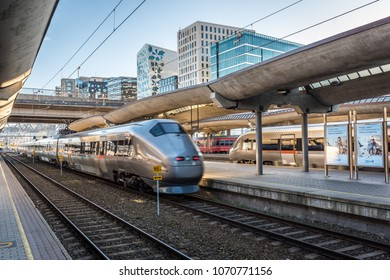 Oslo, Norway - April 2, 2018: Oslo S, Oslo Central Station with Flytoget (airport train express) departing