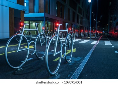 Oslo, Norway - April 2, 2018: Modern Bicycle Parking at night in the center of Oslo in Barcode, Bjørvika district.