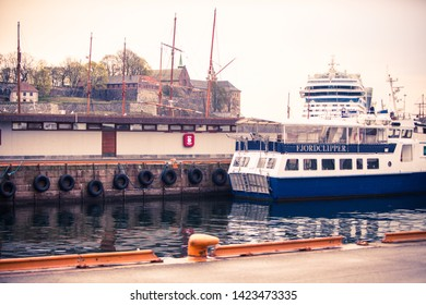 Oslo, Norway - April 25, 2012 : A small fjord tour boat and a huge cruise ship seem to collide