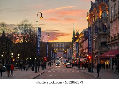 Oslo, Norway: April 25 2017 - Sunset view of Karl Johans gate street in Oslo city center with Royal Palace on the hill.