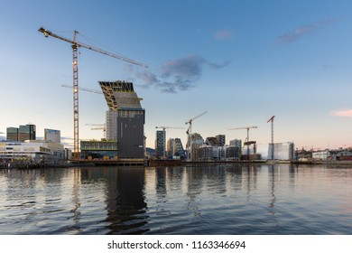 Oslo, Norway -April 27, 2018: Modern buildings known as Barcode Project under construction in the center of Oslo at the sunset