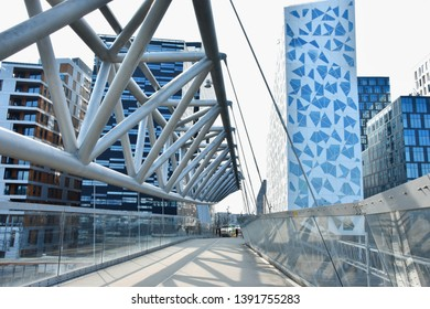 Oslo, Norway: april 3, 2019 - Akrobaten pedestrian bridge in Oslo, Norway during  sunny day.