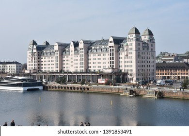 Oslo, Norway: April 3, 2019 - Langkaia place with palace in Oslo is a popular area for walking next the sea, dining, and entertainment with family. Langkaia street in Oslo. Norway
