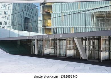 Oslo, Norway: April 3, 2019 - Oslo street view - Norway capital city. Bjorvika modern district and Opera House enter door.