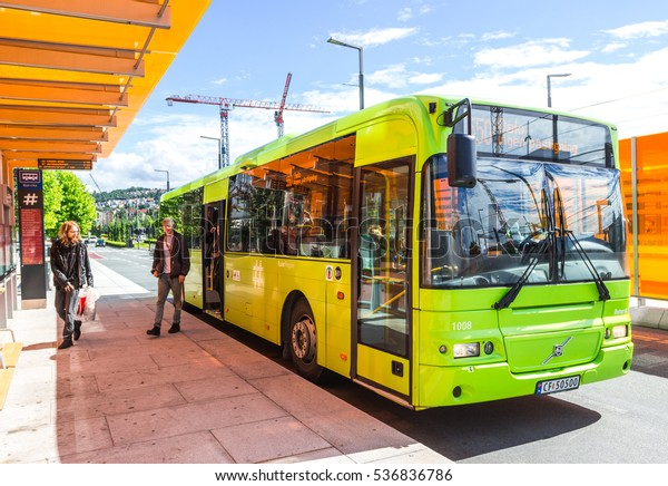 OSLO, NORWAY - AUG 10, 2016. Bright green bus waiting at a bus stop in Oslo downtown