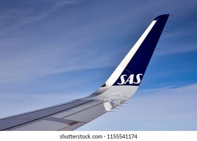 Oslo, Norway - Aug. 13, 2018: SAS airline name/logo on winglet of SAS airplane flying out of Oslo, Norway.