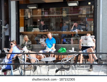 OSLO, NORWAY - AUGUST 16: Unidentified people having lunch in the cafe on 16 August 2012 in Oslo, Norway.