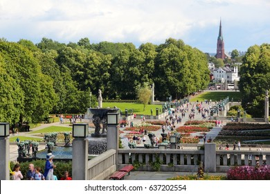 OSLO, NORWAY - AUGUST 2, 2015: People visit gardens and Vigeland Installation in Frogner Park, Oslo. 212 sculptures around the park were all designed by artist Gustav Vigeland.