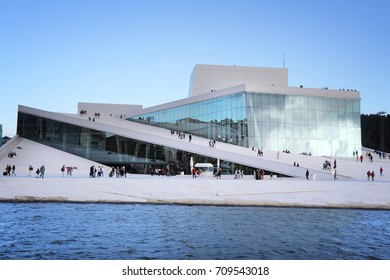 OSLO, NORWAY - AUGUST 2, 2015: People visit Oslo Opera House in Norway. The building designed by Snohetta received Mies van der Rohe Award in 2009.
