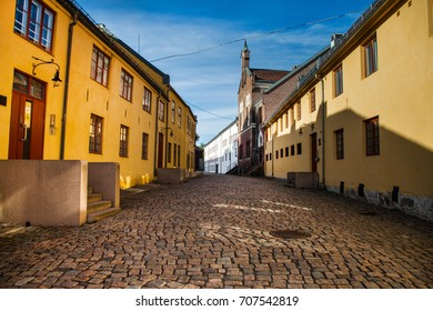 Oslo, Norway. Beautiful city architecture and colors in summer season. Old yellow street. medieval street in Oslo. Medieval red brick castle.