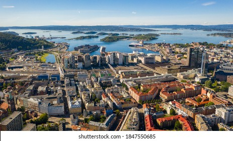 Oslo, Norway. Beautiful panoramic aerial view photo from flying drone for Oslo city center. Against the background of the sea, mountains and blue sky on a sunny summer day. (Series)