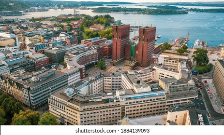 Oslo, Norway. Beautiful panoramic aerial view photo from flying drone to Oslo City Hall is a municipal building in Oslo, the capital of Norway. Against the background of port yachts.