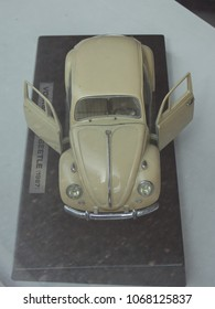OSLO, NORWAY - CIRCA AUGUST 2017: off white Volkswagen Beetle car scale model produced as children toy