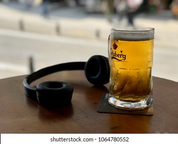 OSLO, NORWAY - CIRCA JULY 2015: a glass of Carlsberg beer with Headphone, brewed in Denmark