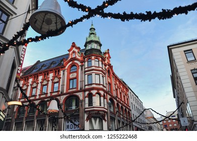 OSLO, NORWAY - December 10, 2018: Karl Johan's street, near the main train station in Oslo. Oslo's main street is decorated for Christmas.