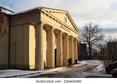 OSLO, NORWAY - DECEMBER 12, 2018: Two men coming out from the Norwegian stock exchange building (Borsen) in Oslo city centre, Norway