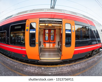 Oslo, Norway - December 28, 2018: Distorted view of the exterior of one of the very successful Stadler FLIRT regional trains operated by Norwegian State Railways around Oslo.