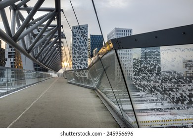 OSLO, NORWAY - DECEMBER 31, 2014: New apartment blocks and a walkway leading to the 'Barcode buildings' development which is a former dock and industrial land in central Oslo.area of Oslo, Norway.