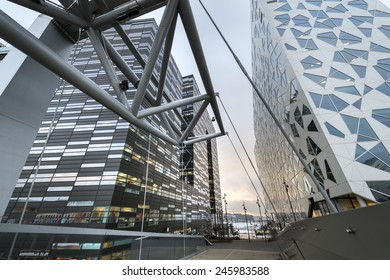 OSLO, NORWAY - DECEMBER 31, 2014: New apartment blocks and a walkway leading to the 'Barcode buildings' redevelopment on former dock and industrial land in central Oslo, Norway.