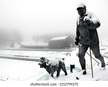 "Oslo, Norway - December 7 2018: Statue of ""King Olaf IV statue and his dog out skiing"" standing at Holmenkollen (ski jumping)."