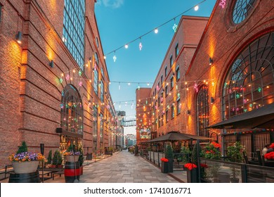 Oslo, Norway. Evening View Of Old Houses In Aker Brygge District. Summer Evening. Famous And Popular Place.