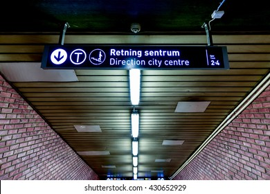 Oslo, Norway - February 28, 2016: Oslo subway (Norwegian T-banen i Oslo). Sign leading to the city centre.