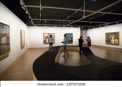 Oslo, Norway - July 04, 2018: Munch-Museet - Museum of the Norwegian artist Edvard Munch in Oslo. Hall with art works, pictures on the walls, visitors.
