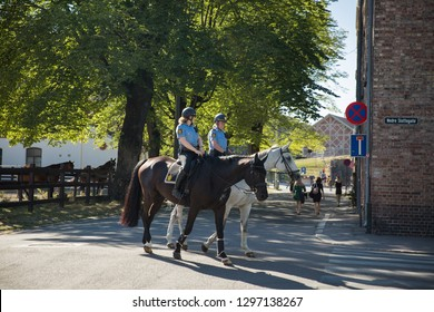 Oslo, Norway - July 04, 2018: Oslo city streets in hot sunny summer day. Female mounted police officers controlling  the order