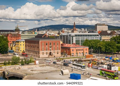 Oslo, Norway - July 18, 2016: People walking in the streets of Oslo and behind them are the buildings -scandinavian architecture.