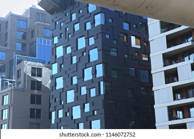 Oslo, Norway - July 19, 2018: Closeup view of modern architecture in Bjorvika district. Buildings in the center of Oslo.