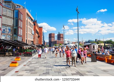 OSLO, NORWAY - JULY 20, 2017: Pedestrian promenade at the Aker Brygge waterfront in Oslo, Norway. Aker Brygge is a popular area for shopping, dining, and entertainment.