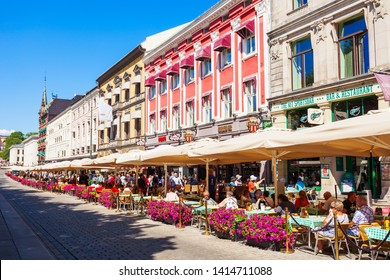 OSLO, NORWAY - JULY 20, 2017: Street cafe at the Karl Johans Gate, the main pedestrian street in Oslo, Norway. Oslo is the capital of Norway.