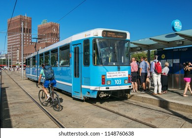 Oslo, Norway, July 21, 2018: People are boarding a tramway at Aker Brygge stop.