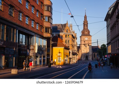 OSLO, NORWAY - JULY 22, 2018: Grensen street leading to the Stortorvet square, one of the most popular tourist attraction in Oslo.  Oslo Cathedral (Oslo domkirke) is seen in background