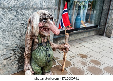 Oslo, Norway July 26, 2013: a stone figure of a Troll with the flag of Norway on a street in Oslo at the entrance to a store. Trolls are evil characters in popular Scandinavian folklore. Editorial