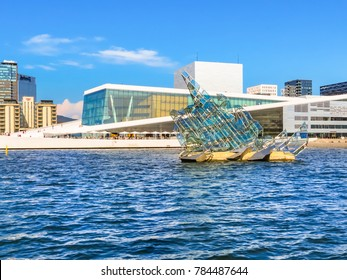 OSLO, NORWAY - JULY 26, 2013: The Oslo Opera House and floating sculpture She Lies in the Oslo Fjord. Oslo, capital of Norway