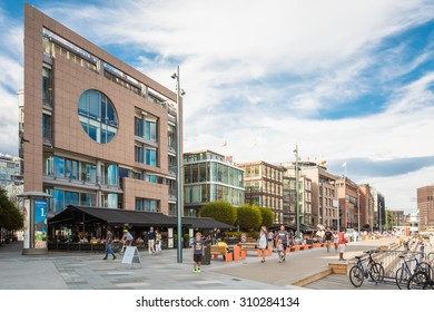 OSLO, NORWAY - JULY 31, 2014: Typical Example Of Scandinavian Architecture. Exterior Building in Aker Brygge is a popular area for for shopping, dining, and entertainment in Oslo, Norway