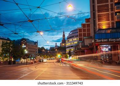 OSLO, NORWAY - JULY 31, 2014: Night View of Biskop Gunnerus gate street in Oslo, Norway. Summer evening
