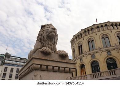 OSLO / NORWAY - JUNE 08 2019:  Stortinget, Parliament of Norway, Lion statue near Norwegian parliament