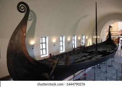 OSLO / NORWAY - JUNE 08 2019: Viking drakkar in Viking museum in Oslo.  Interior of the Viking ship museum.
