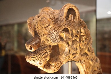 OSLO / NORWAY - JUNE 08 2019: Ancient carved decoration in the form of the head of the beast from Viking Ship Museum