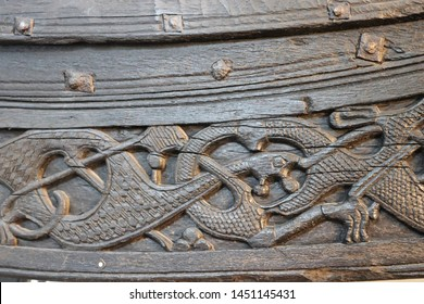 OSLO / NORWAY - JUNE 08 2019: Viking ship tail located in the Viking Ship Museum in Oslo. Viking ship wood carving