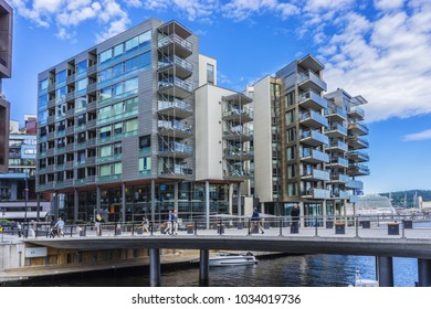 OSLO, NORWAY - JUNE 14, 2017: View of Aker Brygge neighborhood - popular area for shopping, dining, promenade and entertainment area in Oslo.