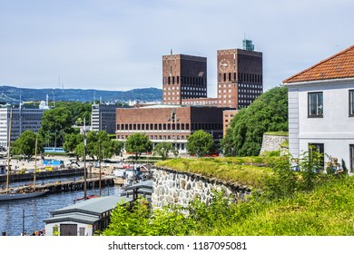 OSLO, NORWAY - JUNE 14, 2017: View of Oslo Fjord, Oslo Harbour and Oslo City Hall (Radhus). Viewed from the ramparts of Akershus Castle.