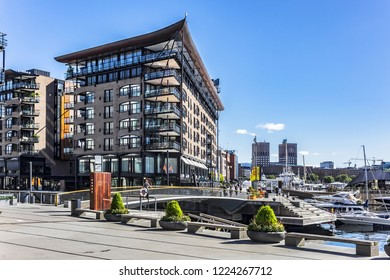 OSLO, NORWAY - JUNE 14, 2017: Aker Brygge - most popular neighborhood in central Oslo: shopping, dining, promenade and entertainment area.